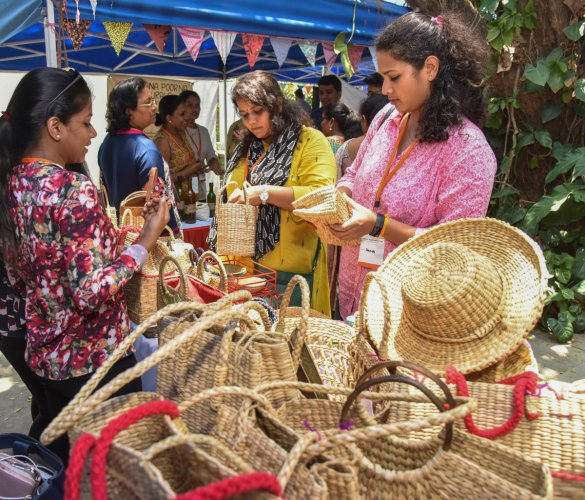 Crafts on display at the Social Start-Up Santhe at IIMB on Friday; (right) visitors enjoy tender coconut. DH photos/S K Dinesh