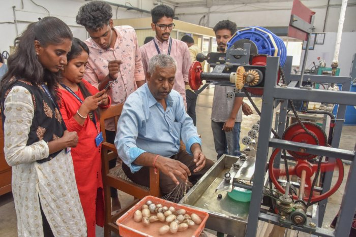 Students look at silk cocoons and reeled silk threads at the National Technology Day organised by the Central SilkTechnological Research Institute at the Central Silk Board in Bengaluru on Saturday. DH PHOTO/S K DINESH