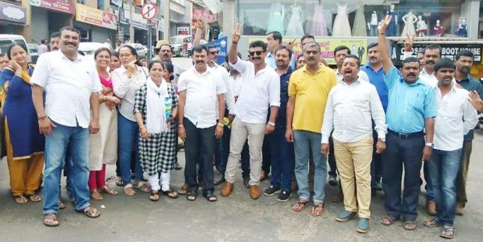 BJP workers celebrate victory at Indira Gandhi Circle in Madikeri on Thursday.