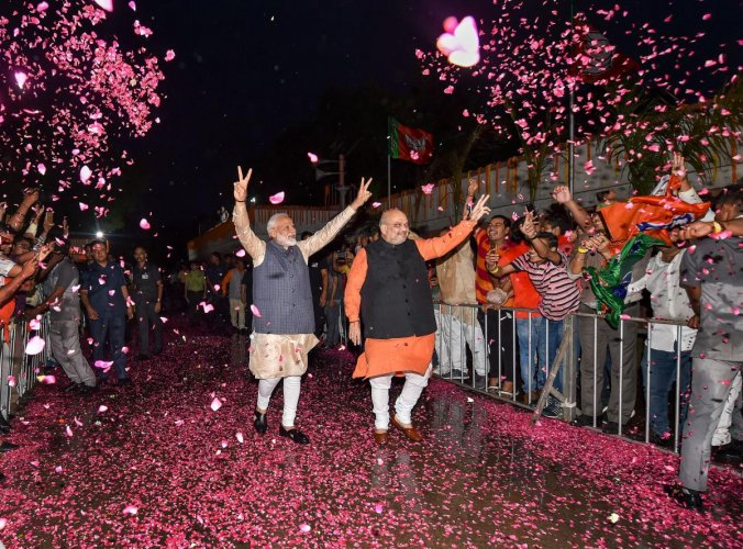 BJP workers welcome Prime Minister Narendra Modi and BJP President Amit Shah at the party headquarters to celebrate the party's victory in the 2019 Lok Sabha elections, in New Delhi on May 23, 2019. PTI