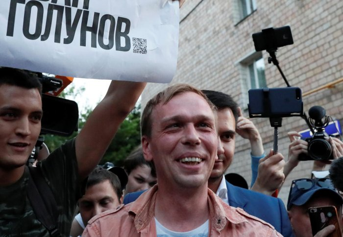 Russian journalist Ivan Golunov (R), who was freed from house arrest after police abruptly dropped drugs charges against him, meets with the media and his supporters outside the office of criminal investigations in Moscow, Russia June 11, 2019. The placar