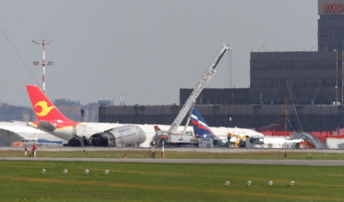 Members of emergency services operate a crane at the scene of an incident involving an Aeroflot Sukhoi Superjet 100 passenger plane at Moscow's Sheremetyevo airport (Reuters File Photo)