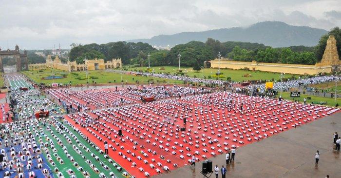People perform Yoga in front of Mysuru Palace, in Mysuru. Dh-file photo