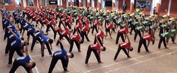 As many as 1,010 students of Coorg Public School in Gonikoppa perform Yogasanas under the guidance of teacher Manthava on Friday.