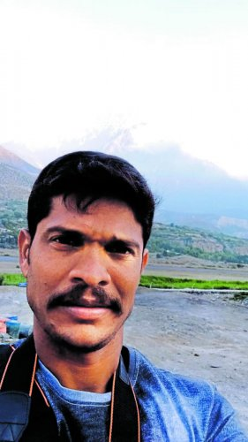 C D Keerthi takes a selfie with Mt Kailash in the background.