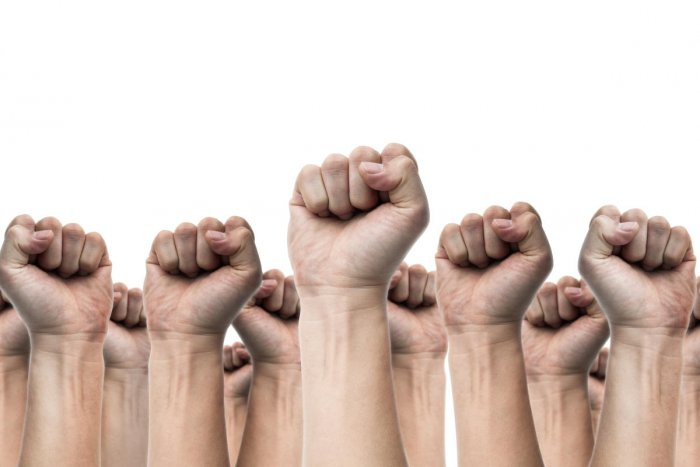movement and protest conceptsUnited people, labor movement, worker strike, election movement, protest illegal election concepts with males fist raised