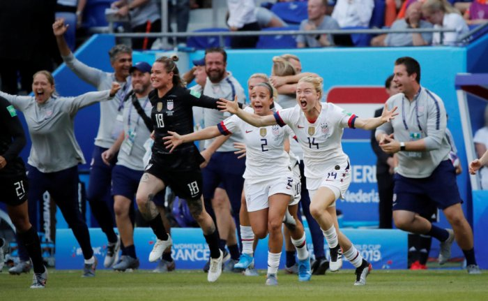 Emily Sonnett of the US, Mallory Pugh of the US and teammates celebrate at the end of the match after winning the Women's World Cup. (REUTERS)