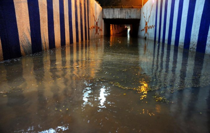 With a few minutes of rainfall, the underpass near KR Circle was seen inundated on Wednesday. DH PHOTO/Pushkar V