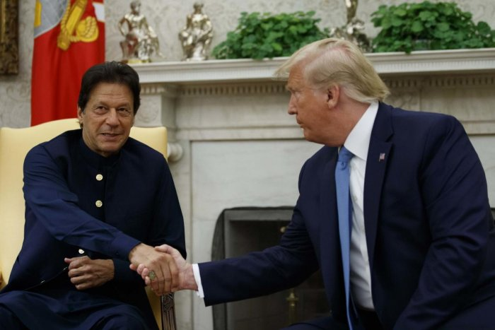 US President Donald Trump shakes hands with Pakistani Prime Minister Imran Khan during a meeting in the Oval Office of the White House. (AP/PTI Photo)