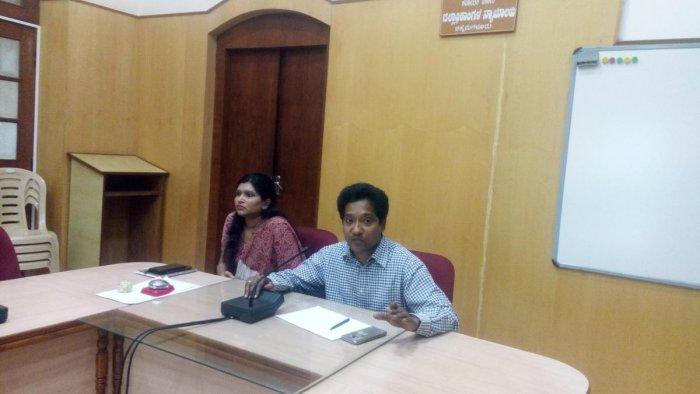 Deputy Commissioner Dr Bagadi Gautham speaks at a meeting in Chikkamagaluru on Tuesday. Zilla Panchayat CEO S Ashwathi looks on.