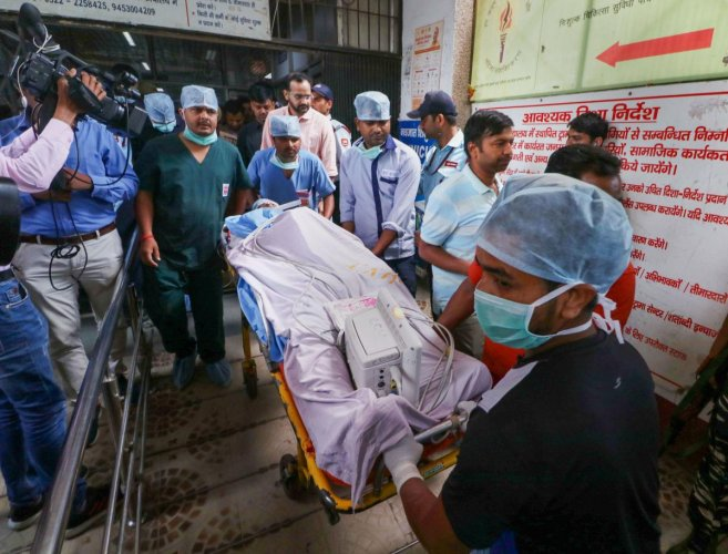 Unnao rape survivor's lawyer being shifted to an ambulance outside the KGMC Trauma Centre before being airlifted to New Delhi for further treatment (PTI file photo)