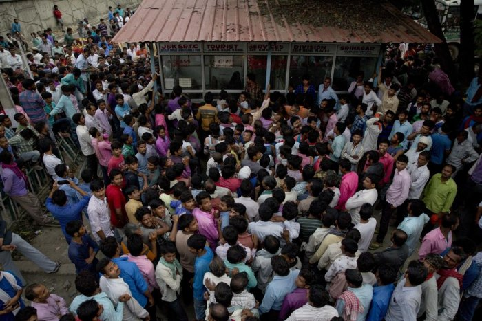 Migrant workers crowd outside the government transport yard to buy bus tickets to leave the region, during curfew in Srinagar. (AP/PTI File Photo)