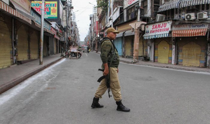 Security personnel stand guard during restrictions, in Jammu, Friday Aug 9, 2019. (PTI Photo)