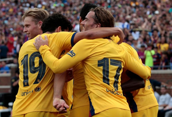 A crowd of 60,043 at 110,000-seat Michigan Stadium in Ann Arbor, Michigan, was treated to an exquisite passing display by Barcelona, which netted four goals in 15 minutes to seal Napoli's fate. (AFP Photo)