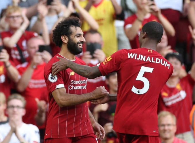 Liverpool's Mohamed Salah (left) celebrates with Georginio Wijnaldum after scoring their third goal against Arsenal on Saturday. Reuters