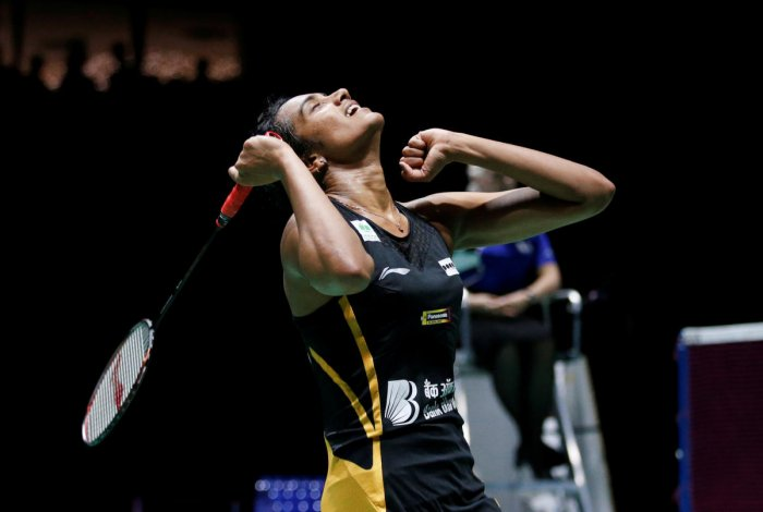 PV Sindhu cheers after winning her women's singles final match against Japan's Nozomi Okuhara at the BWF Badminton World Championships in Basel, Switzerland, Sunday, Aug. 25, 2019. AP/PTI