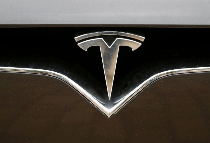 The Tesla logo is pictured on a car during the electric car E-Rallye Baltica 2019 in Bauska, Latvia, July 23, 2019.(Photo by Reuters)