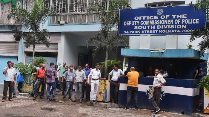 Police personnel in plain clothes seen outside the official residence of former Kolkata Police Commissioner Rajeev Kumar. PTI Photo