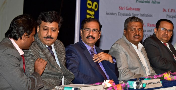 Dr Ramaraju H K, chief of civil engineering department of Dayananda Sagar College of Engineering has a word with Bescom managing director and alumnus of the college M B Rajesh Gowda during the seminar as managing director of Kudremukh Iron Ore Company MV