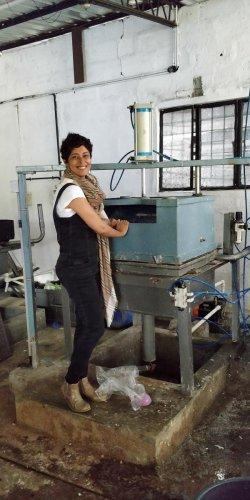 Kavya with a machine she designed.