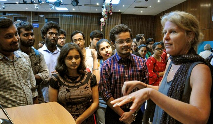 NASA's Lead Flight System Engineer, Mars 2020 Rover, Ann Devereaux (R) interacts with the students during a session at American Center, in Kolkata, Wednesday, Sept 25, 2019. (PTI Photo)