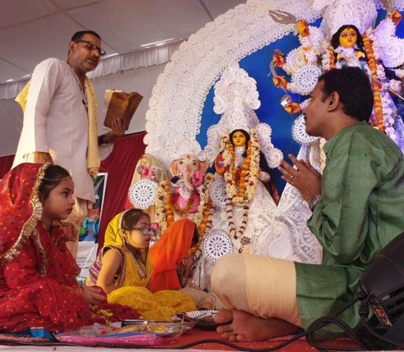 Izna Ali (dressed in red) is being worshipped during the Kumari Puja ritual. Special arrangement