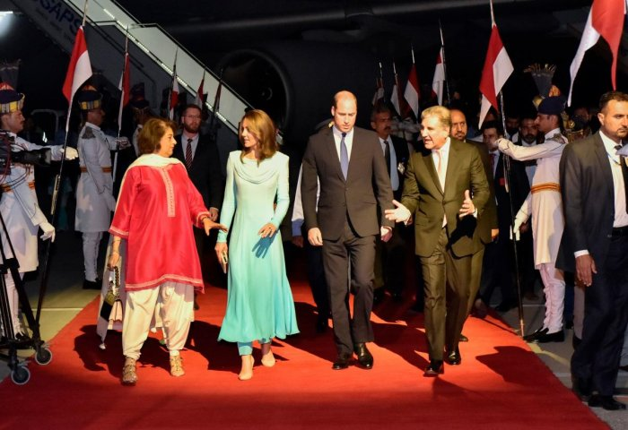Britain's Prince William, Duke of Cambridge (Center R) and his wife Britain's Catherine, Duchess of Cambridge (Center L) are welcomed by Pakistan's Foreign Minister Shah Mehmood Qureshi (R) upon their arrival at the Pakistan's Nur Khan military airbase in