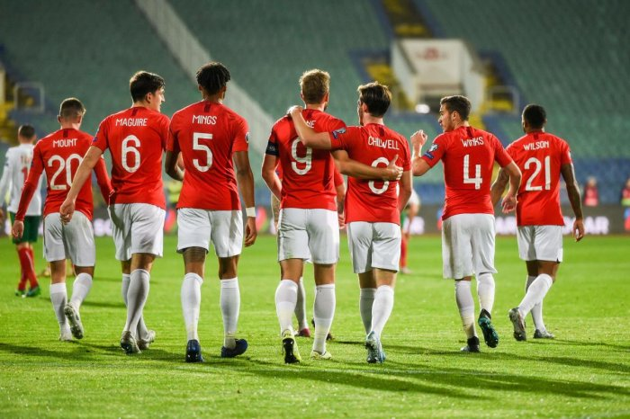England's forward Harry Kane (C) celebrates with his teammates after scoring a goal during the Euro 2020 Group A football qualification match between Bulgaria and England due to incidents with fans, at the Vasil Levski National Stadium in Sofia on October