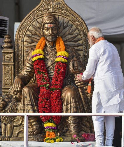Prime Minister Narendra Modi pays tribute to Chhatrapati Shivaji Maharaj during an election campaign rally, ahead of Maharashtra Assembly elections, at Kharghar in Navi Mumbai on Wednesday. (PTI Photo)