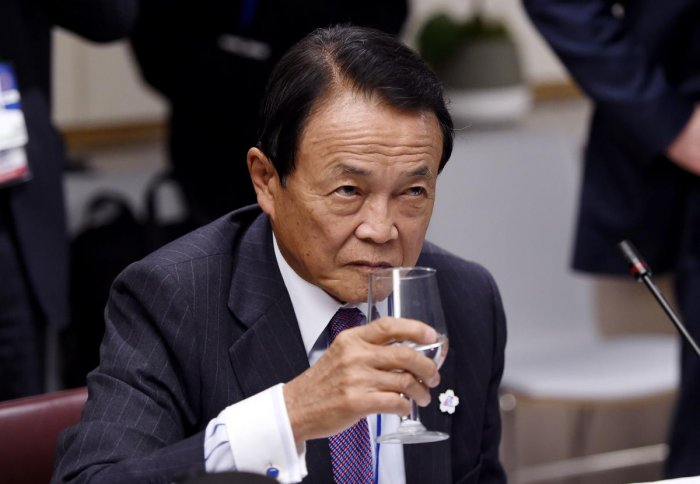 Japan's Finance Minister Taro Aso looks drinks water during a meeting between the Finance Ministers and Central Bank Governors of the G7 nations during the IMF and World Bank Fall Meetings in Washington, DC. AFP