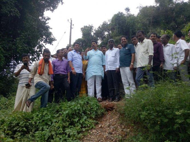 Revenue Minister R Ashoka inspects the damaged hanging bridge across River Nethravathi near Uppinangady on Monday.