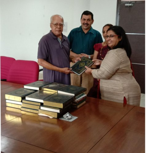 John B Monteiro of Johnlyn Toy Exchange and Book Bank hands over books to an educational institution in Mangaluru.