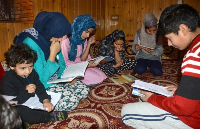 A group of students prepare for Class 10th board examinations, in Srinagar. (PTI Photo)