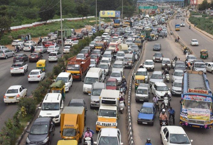 Vehicles stuck in a huge traffic jam on airport road near Hebbal during the rally of Congress leader D K Shivakumar in Bengaluru on Saturday. DH Photo/Janardhan B K