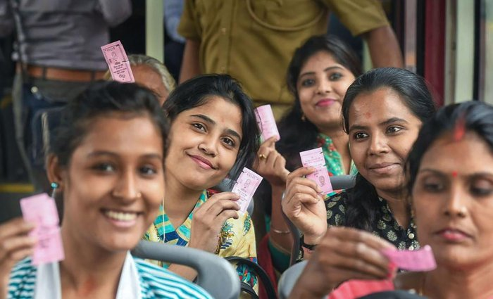 Women passengers show their 'pink tickets' while travelling by a DTC bus in New Delhi on Tuesday. (PTI Photo)