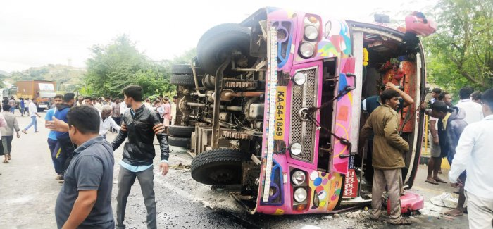 The private bus which toppled near Agrahara village in Koratagere taluk of Tumakuru district, killing five people on the spot. DH Photo