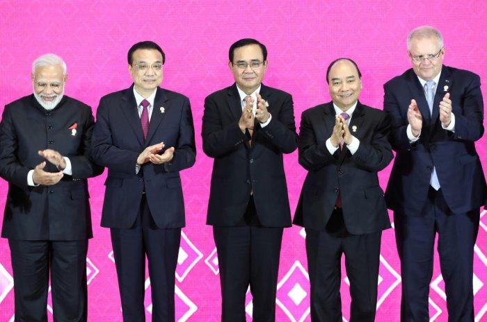 India's Prime Minister Narendra Modi, Chinese Premier Li Keqiang, Thai Prime Minister Prayuth Chan-Ocha, Vietnam's Prime Minister Nguyen Xuan Phuc, and Australia's Prime Minister Scott Morrison clap their hands at the 3rd Regional Comprehensive Economic P