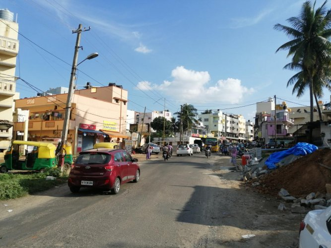The land for road-widening in Halagevaderahalli, RR Nagar, was acquired two years ago. DH PHOTO/SANDESH MS