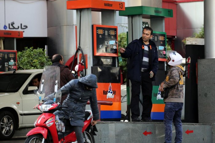 Iranians fill their vehicles at a petrol station in Tehran. (Photo by AFP)