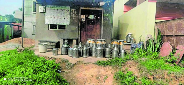 Milk cans pile up outside the KMF milk collection point at Agara village in Kanakapura taluk, Ramanagara district, on Sunday morning after KMF officials refused to collect them. SPECIAL ARRANGEMENT