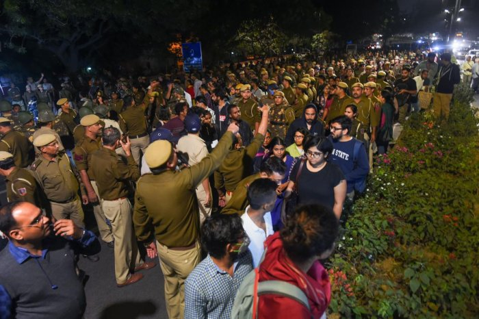 Jawaharlal Nehru University students block a road as they protest demanding a total rollback of the hostel fee hike, in New Delhi. (PTI Photo)