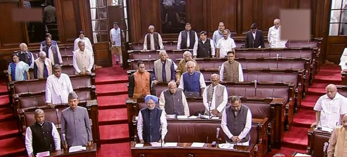 Parliamentarians observe silence during an obituary reference in the Rajya Sabha during the Winter Session of Parliament, in New Delhi. (PTI Photo)
