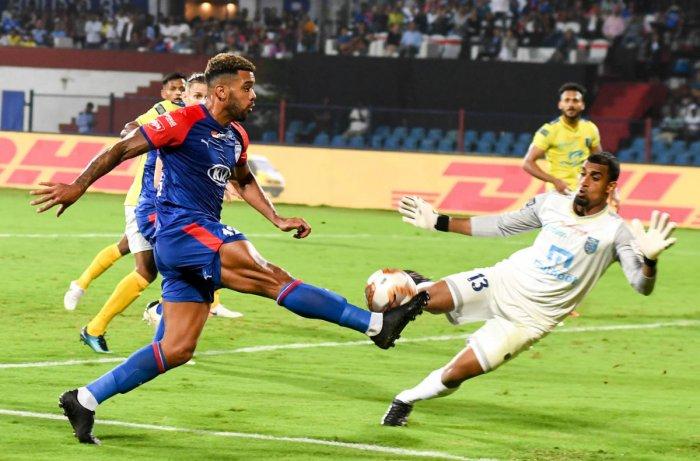 TP Rehenesh ofKerala BlastersFC tries to block Bengaluru FC midfielder Raphael Augusto's effort during their ISL match at the Sree Kanteerava Stadium in Bengaluru onSaturday. DH Photo/ B H Shivakumar