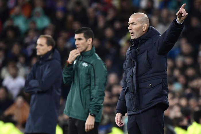 Real Madrid's French coach Zinedine Zidane gestures during the UEFA Champions League group A football match against Paris Saint-Germain FC. (AFP Photo)