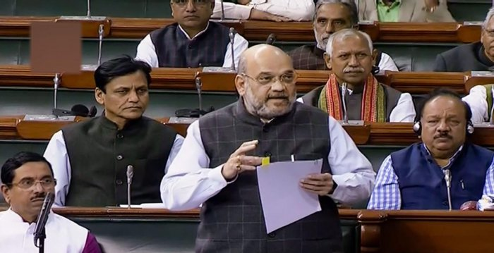 Union Home Minister Amit Shah speaks in the Lok Sabha during the Winter Session of Parliament. (PTI Photo)