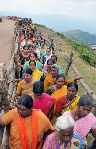 Women wait in a queue for the Darshana of Datta Paduke at Bababudangiri. dh photos
