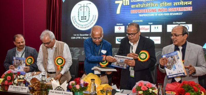 Dignitaries release a souvenir during inaugural ceremony of the seventh Bioprocessing India Conference at Central Food Technological Research Institute in Mysuru on Saturday. Director General (DG), the Council for Scientific and Industrial Research (CSIR)