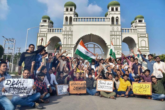 Students hold placards as they raise slogans during a protest against Citizenship Amendment Act (CAA) and National Register of Citizens (NRC) at Maulana Azad National Urdu University in Hyderabad, Tuesday, Dec. 17, 2019. (PTI Photo)