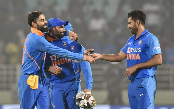 ndian captain Virat Kohli celebrates with pacers Md Shami and Deepak Chahar after their win in the 2nd ODI cricket match against West Indies at ACA-VDCA Cricket Stadium in Visakhapatnam, Wednesday, Dec. 18, 2019. (PTI Photo