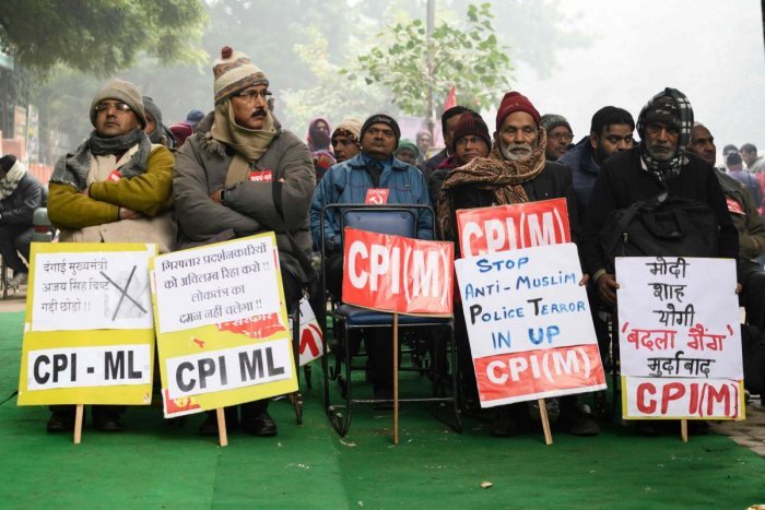 Activists of the Communist Party of India (CPI) display placards during a demonstration against India's new citizenship law in New Delhi on December 30, 2019. (AFP Photo)